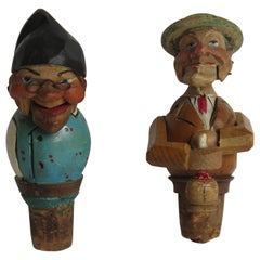 Two Folk Art Wine Bottle Stoppers Wood Hand Carved Articulated, circa 1930
