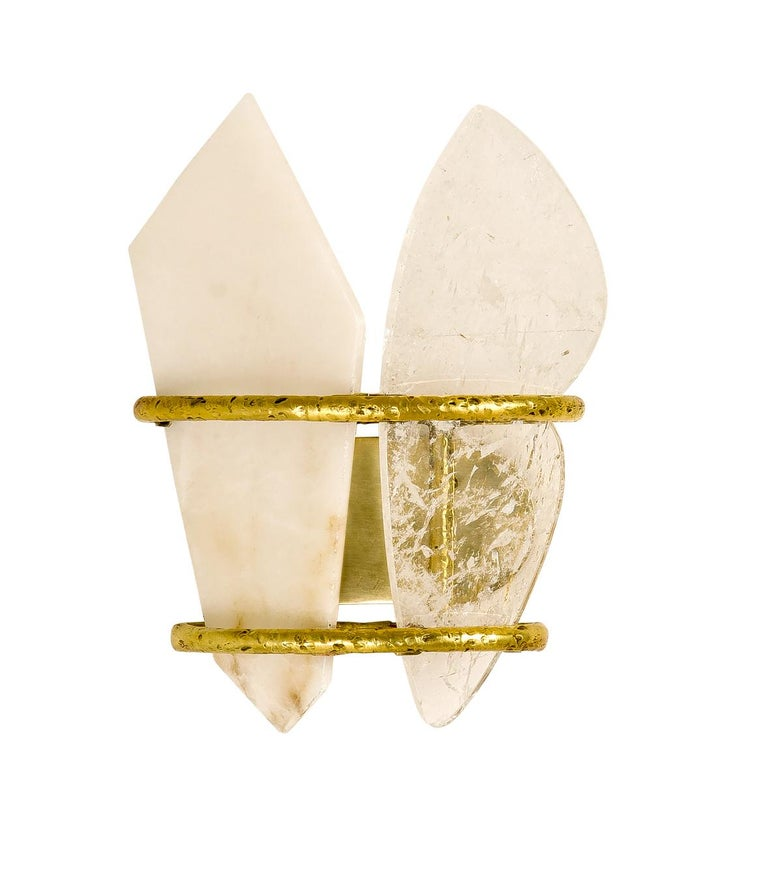 Two-free wall is a sculpture object, 100% made in Tuscany , Italy, with the mastery of craftsmen that are working with Sabrina with passion and long experience.  This light sconce is delicate and luminous, a sophisticated piece that enriches with