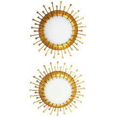 Two French 1940s Gilt Iron Milk Glass Sunburst Light Fixtures with Nails Details