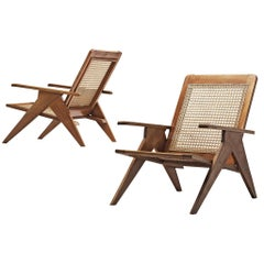 Two French Lounge Chairs in Cane and Mahogany