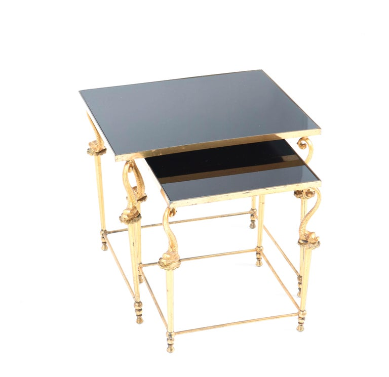 Stunning pair of Hollywood Regency side tables.