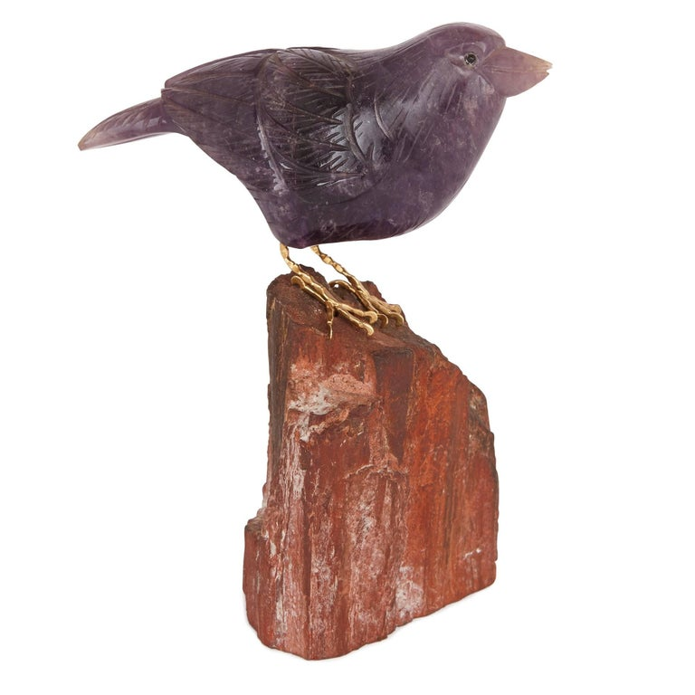 This beautiful pair of bird models have been fashioned from the semi-precious stones amethyst and lapis lazuli, both renowned for their brilliant, intense colouring. They are shown in startlingly naturalistic poses, perched on natural mineral