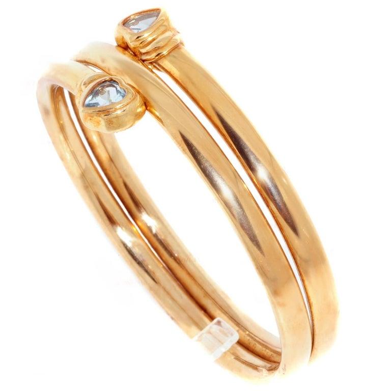 Two Hearts Blue Topaz Yellow Gold Bangle Bracelet
