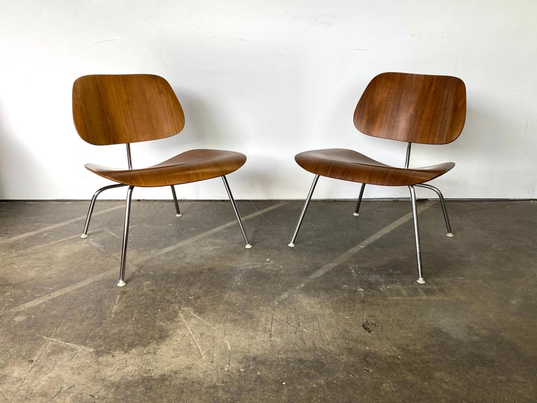 In our opinion the most elegant Eames chair design. The molded plywood shells are finished in a warm walnut hue. The sculptural shells affixed to the lithe yet sturdy chrome finishes steel rod frame create an airy silhouette. Also a very comfortable