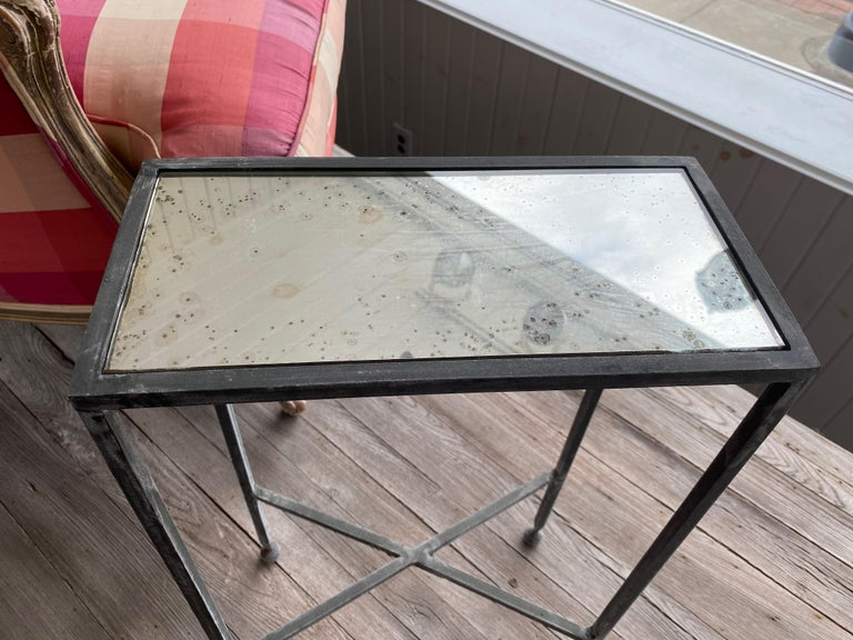 Two iron and antiqued mirror drinks table in the style of Maison Baguès.