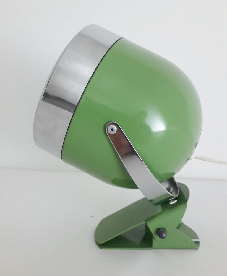 Vintage Italian adjustable spotlight with glossy green enameled body and chrome hardware, mounted with simple clip base, can be used as wall light or table lamp / Made in Italy circa 1970s 1 light / E14 type / max 40W Measures: Height 7 inches /