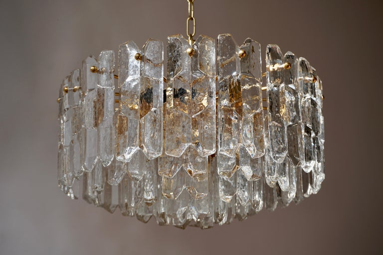 Two very exquisit 24-carat gold-plated brass and clear brillant glass light fixtures by J.T. Kalmar, Vienna, Austria, manufactured in midcentury, circa 1970 (late 1960s and early 1970s).   The model name is 'Palazzo'. The lamps are marked with a
