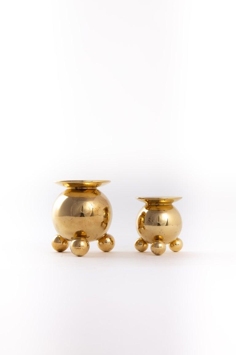 Two very heavy brass metal candleholders. Marked on the bottom. Size of the diameter for the candles is 20mm.
