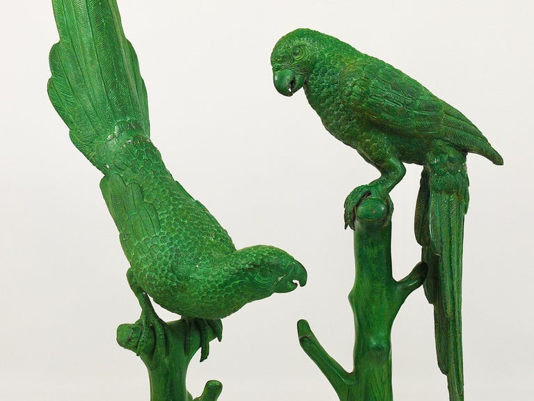 Two beautiful and large French bronze sculptures / figurines from the 1970s, displaying parrots sitting on a branch. Very impressive and decorative objects in good condition. Measures: Height 25 and 34 inches. Sold and prices per piece.
