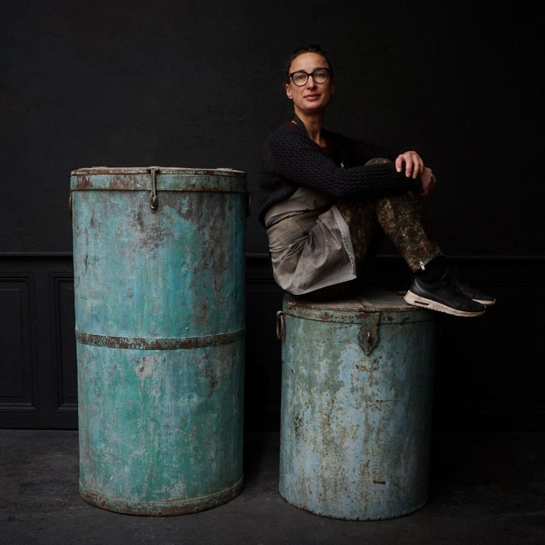 Beautiful Industrial metal barrels or drums with hinged lids. Not quit sure what they were used for, probably for any kind of dry goods that had to be stored. This old turquoise rustic worn metal patine color is perfect. You could use them as high