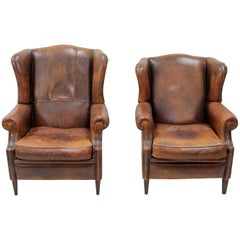 Two Leather Wingback Lounge Chairs