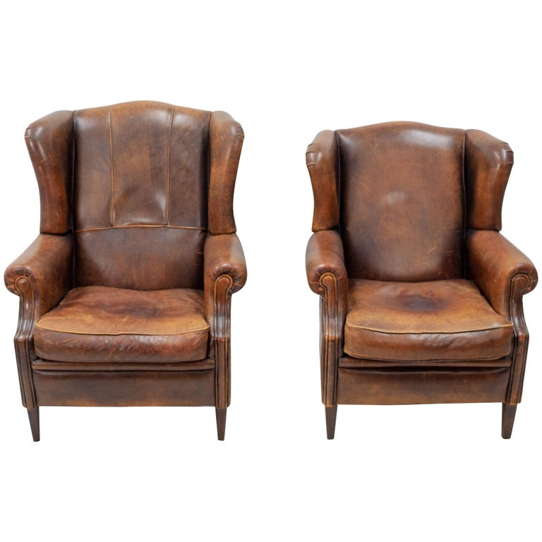 Two Leather Wingback Lounge Chairs For