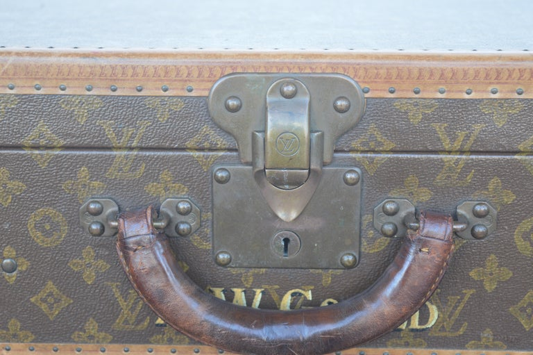 Two Louis Vuitton trunks.