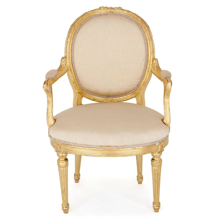 These beautiful late 19th-century fauteuils (armchairs) are designed in the style of furniture crafted in France in the Louis XVI period (1774-92). 