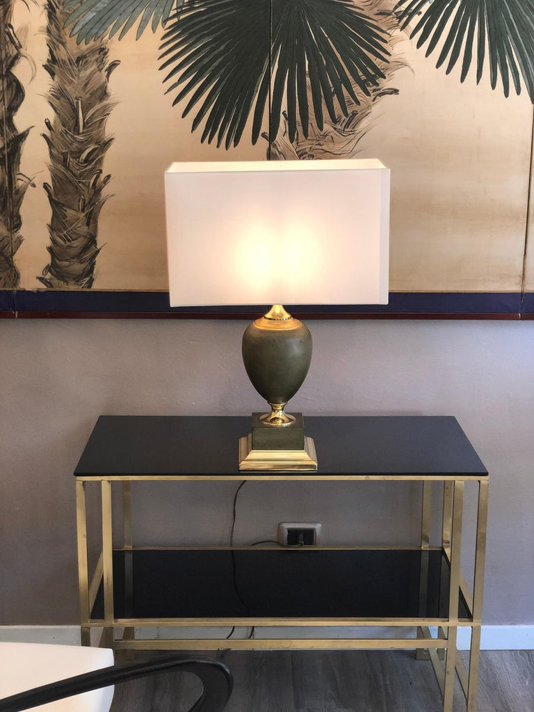 Maison Le Dauphin a pair of Regency leather and brass table lamps   Maison Le Dauphin - a pair of Regency table lamps signed Le Dauphin. The lamps are made of leather and brass. They are from 1970s from France.  They are made by Maison Le