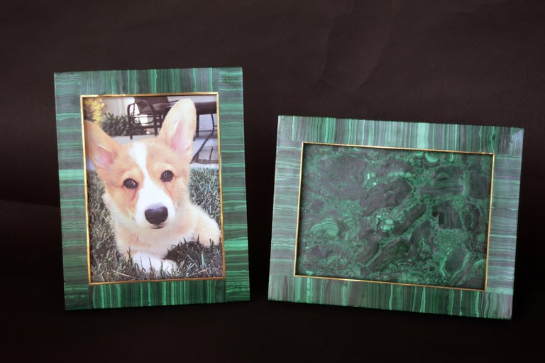 Two malachite picture frames. One is Landscape measuring 10 inches wide x 7.75 inches high. The other is Portrait. Each have a bronze inner frame. Both hold pictures measured at 5.75 inches x 8 inches.