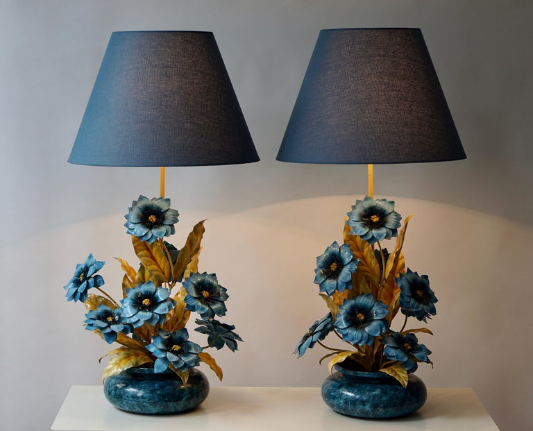 Two metal painted flower table lamps.  Diameter base: 40 cm.  Height base 64 cm.  Height with shade 84 cm.  Diameter shade 42 cm.