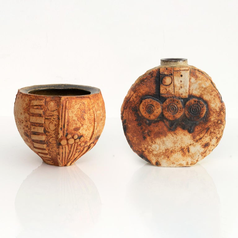 """Two Mid-Century Modern expressionistic ceramic studio vases by British potter and artist Bernard Rooke. The vases are partially glazed and are detailed with raised surface patterns.  Measures: Height 5.5', diameter 7""""  Height 8"""", depth 2.5""""."""