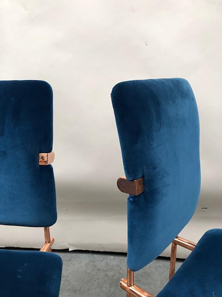 Two dining chairs with copper-plated frames and velvet upholstered seating. The velvet fabric is by Dedar. The copper will aged and will get a patine. The Mid-Century Modern chairs are new (showroom models). Model name of the elegant chair is Jodie