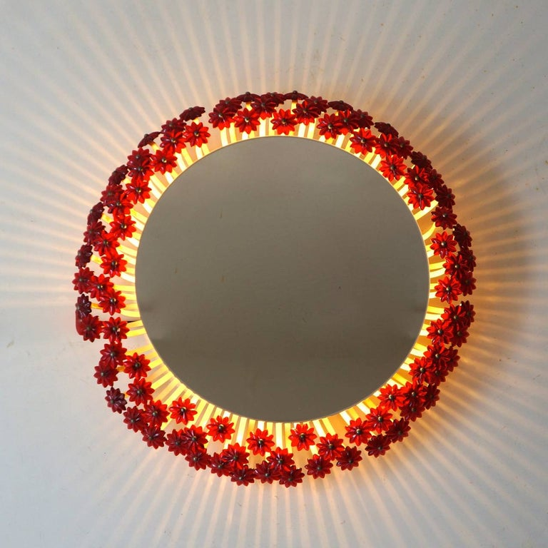 Two amazing illuminated round mirrors with background illumination and brass and Lucite flowers by Emil Stejnar. Looking in this mirror will turn you into a princess when you pull the cord switch.  Measure: Diameter 42 cm.