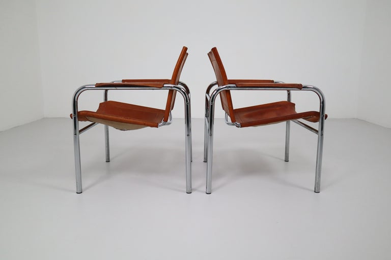 Bauhaus Two Midcentury Tubular Armchairs in Patinated Cognac Leather, France, 1960s For Sale