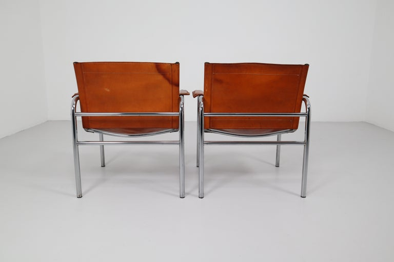 French Two Midcentury Tubular Armchairs in Patinated Cognac Leather, France, 1960s For Sale