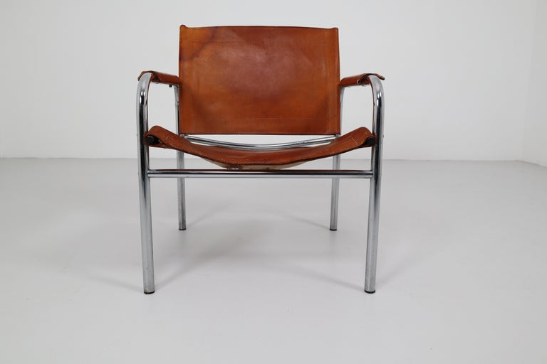 Two Midcentury Tubular Armchairs in Patinated Cognac Leather, France, 1960s In Fair Condition For Sale In Almelo, NL