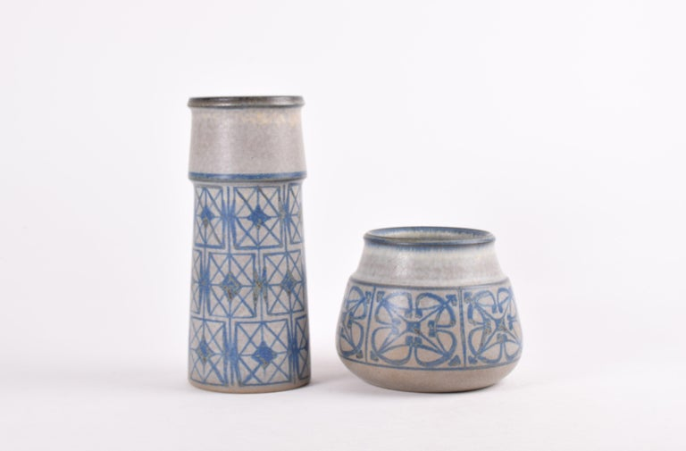 Set of two midcentury Danish vases designed by Marianne Starck for Michael Andersen & Søn and made circa 1960s. Both vases are made of stoneware and belong to the same series.  They both have a matte gray, blue and brownish glaze.  Tall vase: