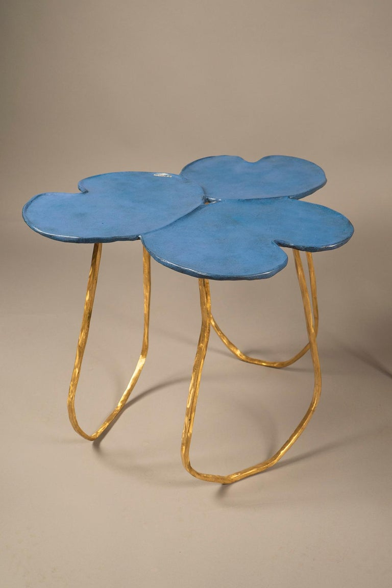 Sculptural side tables in the shape of lily pads (nenuphar) with a pale blue patina, raised on three polished bronze feet. Each table comes with a loose bronze flower.