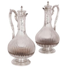 Two Neoclassical Style Silver and Crystal Claret Jugs