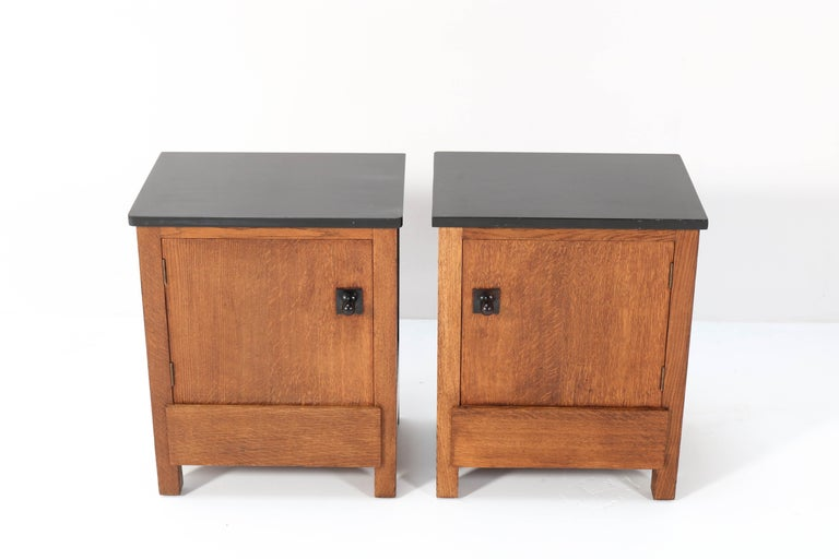 Magnificent and rare pair of Art Deco Haagse School nightstands or bedside tables. Design by Henk Wouda for H. Pander & Zonen. Striking Dutch design from the 1920s. Marked with original manufacturers metal tag and brand mark. In very good