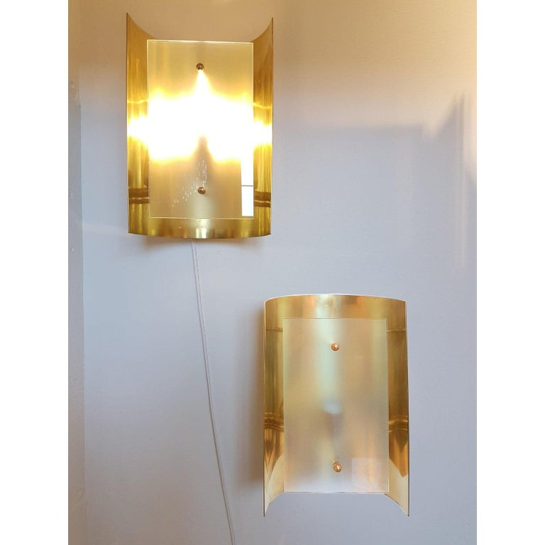 Offered by Dlightus: Made of a single polished brass sheet, curved, nesting 1 candelabra base light, and covered up by a frosted glass. Customizable: dimensions and metal finish. We can make it in brass, chrome, nickel or painted metal. Pure