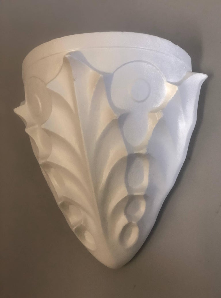 Two pairs of French Mid-Century Modern plaster or white terracotta sconces in the style of Alberto and Diego Giacometti for Jean Michel Frank.   Elegant pieces integrating surrealist, neo-baroque and modern influences that feature acanthus leaf