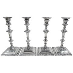 Two Pairs of English Georgian Sterling Silver Candlesticks