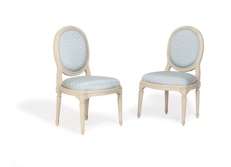A pair of French white painted Louis XVI armchairs and chairs(4pcs). Signed Nadal. Maker Jean-René Nadal, 1733-1783.  The regal set of Nadal chairs consisting of two arm chairs and two side chairs are each stamped with the makers name. They are