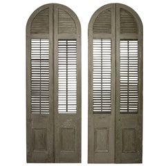 Two Pairs of Green-Painted Arched Shutters