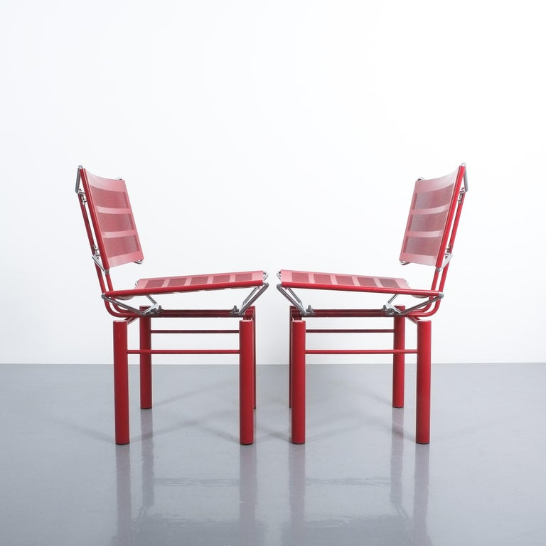 Two pairs of red Hans Ullrich Bitsch chairs Series 8600, circa 1980. Postmodern classic with perforated backrest and seat and highly delicate metal joints. Very good original condition with some minor color losses. We sell them as sets of 2. Total