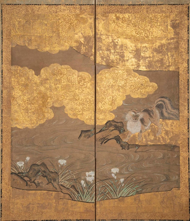 A two-panel screen depicting a musk cat under a cherry tree with gilt decoration. Based on the Kano School, Japanese.