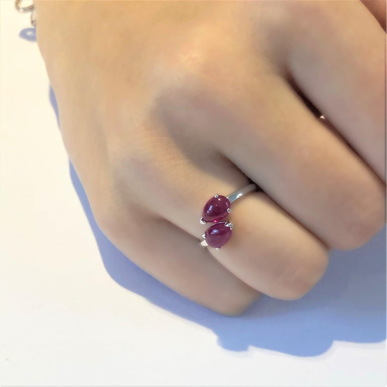 Contemporary Two Pear Shape Cabochon Ruby Facing Gold Cocktail Ring For Sale