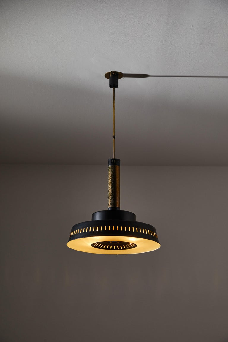 Two pendants by Stilnovo. Manufactured in Italy, circa 1960s. Brass, enameled metal, glass. Custom brass ceiling plates. Rewired for U.S. standards. Each light takes one E27 60w maximum bulb. Bulbs provided as a one time courtesy. Priced and sold