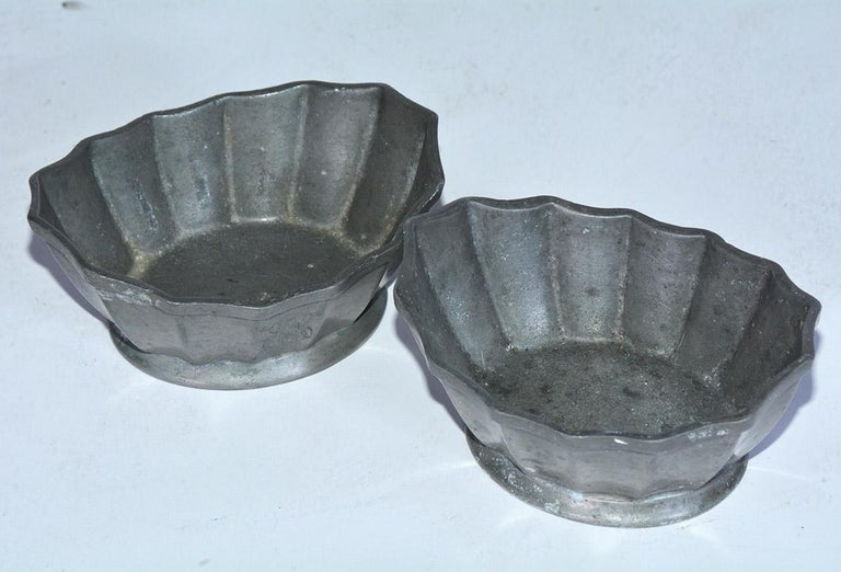 Two small antique fluted open salt and pepper dishes or bowls in handwrought pewter with wonderful aged patina. Can easily be used as soap dish to hold small guest soaps, bedside decorative container or vessel for rings and earrings or other Knick