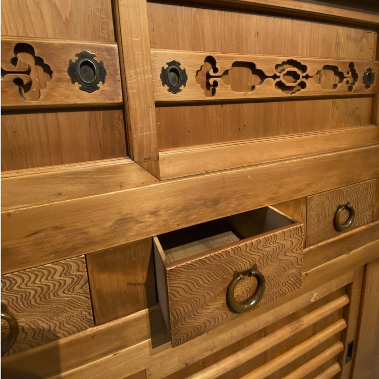 Two piece kitchen (Mizuya) tansu, Japanese, Meiji period. Upper portion consist of sliding doors, small pull out door, five drawers. Lower portion has sliding doors and four drawers on the right. Handles are made of hand forged copper, hikites are