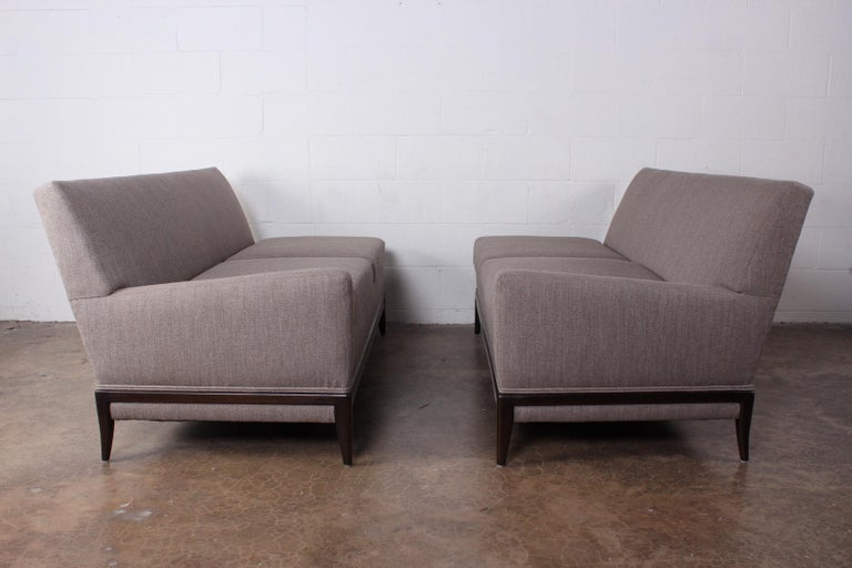 A two piece sofa designed by Tommi Parzinger for Parzinger originals.