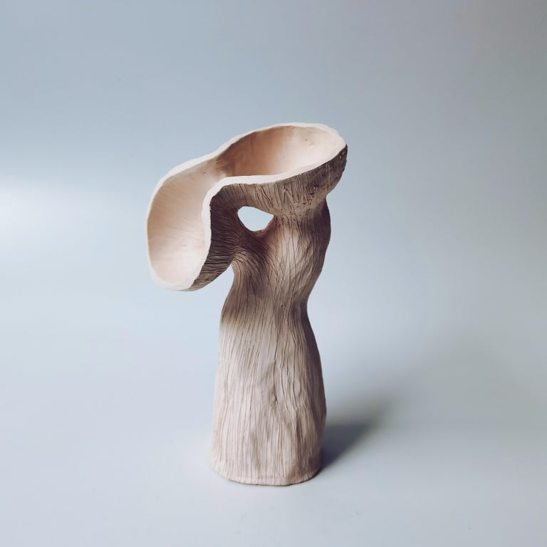Two pod, One stem small by Jan Ernst Dimensions: H 25 cm Materials: White stoneware  Jan Ernst's work takes on an experimental approach, as he prefers making bespoke pieces by hand. His organic design stems from his abstract understanding of