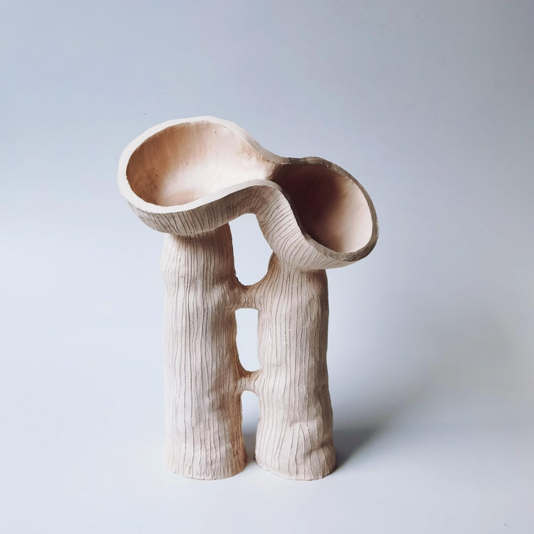 Two Pod, Two Stem by Jan Ernst Dimensions: H 35 cm Materials: White Stoneware  Jan Ernst's work takes on an experimental approach, as he prefers making bespoke pieces by hand. His organic design stems from his abstract understanding of form and