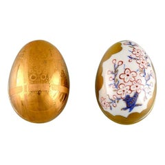 Two Porcelain Easter Eggs with Hand-Painted Flowers and Gold Decoration