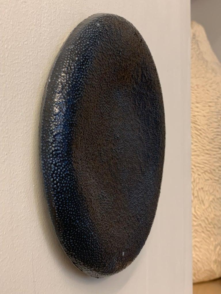 Cast Two Porcelain Wall Sculptures