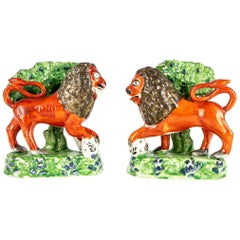Two Rare Compatible Early 19th C. Creamware Staffordshire Lion Figures with Boca