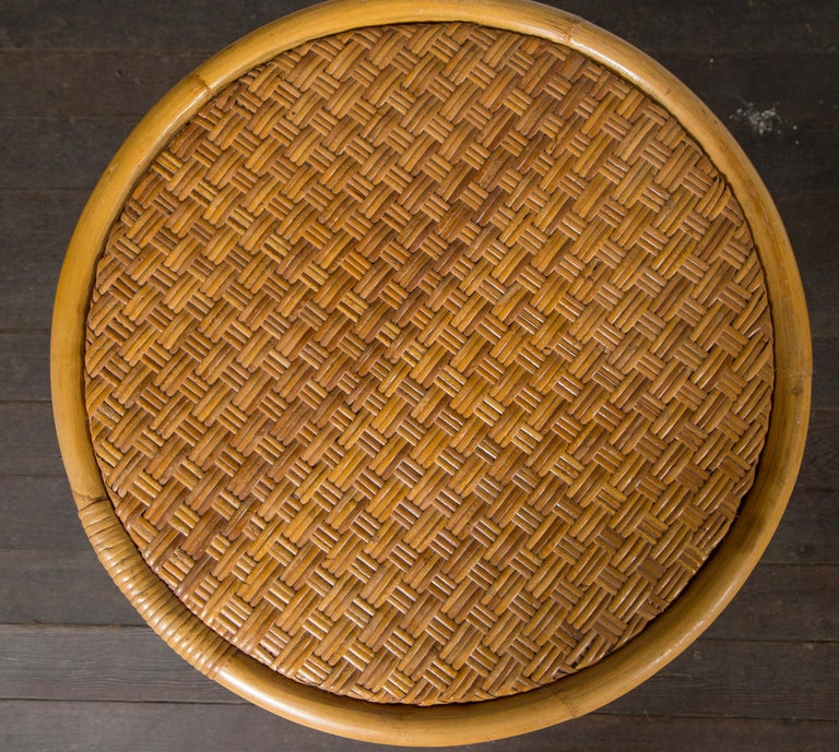 Sturdy, well-made rattan round side table and square rattan ottoman. Both in beautiful condition. Ottoman is 20 inches square, 10.5 inches high.