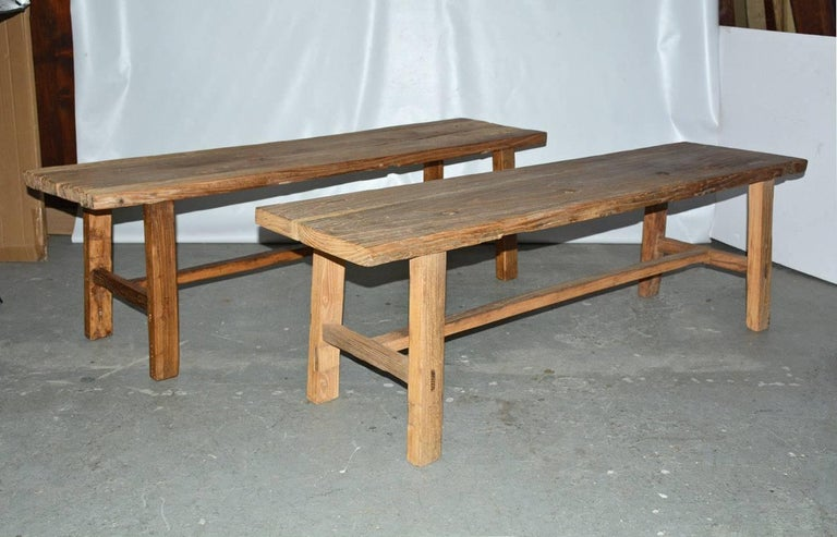 Rustic, country style elm wood bench made from reclaimed wood can be used as rustic coffee table or dining table seating. Two similar benches are available.